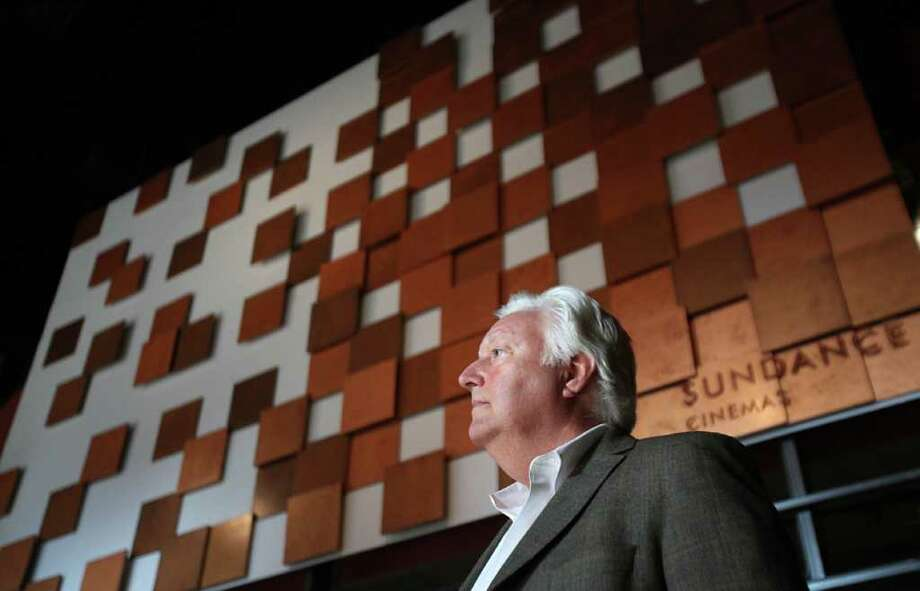 MAYRA BELTRÁN PHOTOS : CHRONICLE TOUR: Paul Richardson, president and CEO of Sundance Cinemas, checks out the company's first Texas theater, located in Bayou Place, on Wednesday. Photo: Mayra Beltran / © 2011 Houston Chronicle