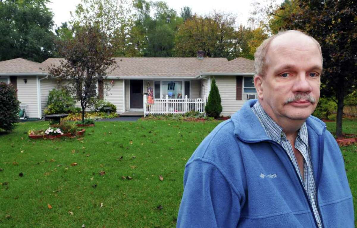 Stephen Cadalso in front of his Rielton Court home in the Westmere neighborhood near the Crossgates Mall Wednesday Oct. 26, 2011. (John Carl D'Annibale / Times Union)