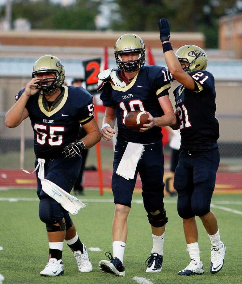 Quarterback Tyler Stehling, flanked by Steve Bruce (55) and Gavin Orgeron (21), must lead Klein Collins to one win in the next two games to reach the playoffs. Photo: Bob Levey / ©2011 Bob Levey