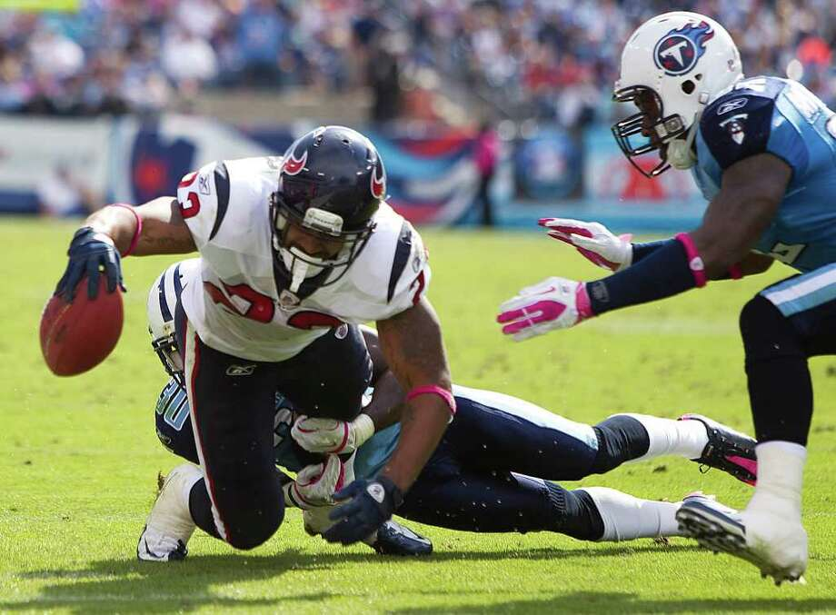 Arian Foster, who topped 100 yards rushing and 100 yards receiving in Sunday's 41-7 win at Tennessee, was voted AFC Offensive Player of the Week. Photo: Brett Coomer / © 2011  Houston Chronicle