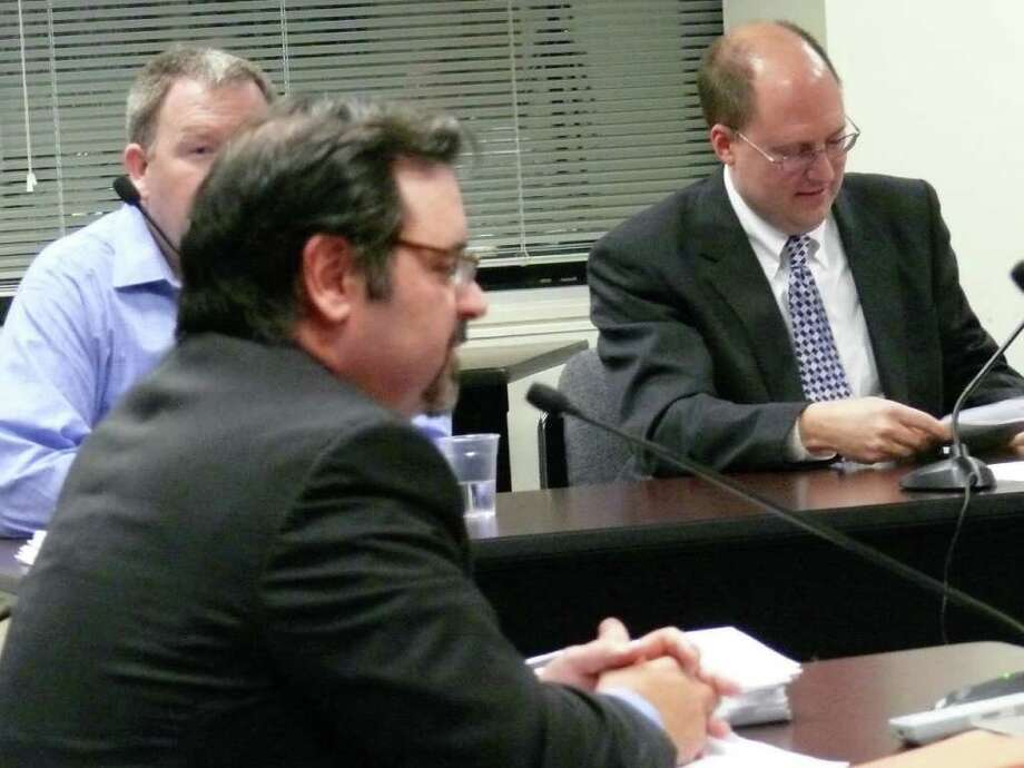 Board of Finance members on Wednesday reviewed the legal analysis of financial problems besetting the Fairfield Metro project. In foregrouns is Richard VItarelli, a lawyer hired to conduct the analysis, with board Vice Chairman Robert Bellitto, right, and Chairman Tom Flynn in background. Photo: Genevieve Reilly / Fairfield Citizen