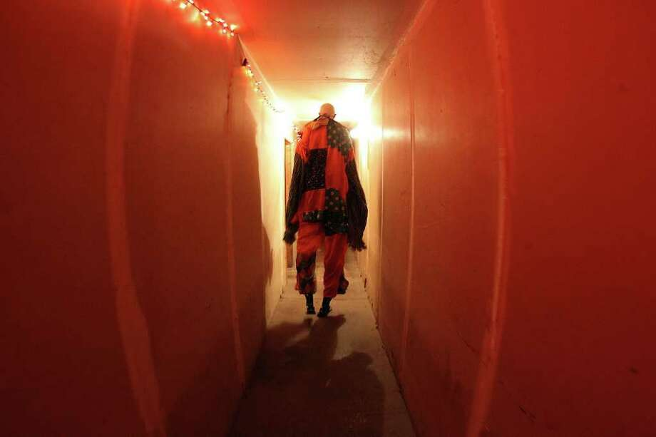 Actor Jerome Barideaux walks down an eerie-looking hallway to his spot to frighten guests at Nightmare on Grayson Street on Wednesday, Oct. 26, 2011. Barideaux wore mechanical stilts to make his appear over seven feet tall. Kin Man Hui/kmhui@express-news.net Photo: Kin Man Hui, / / San Antonio Express-News