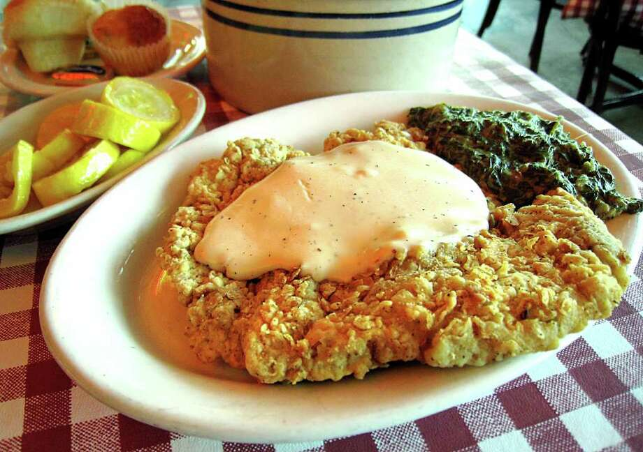 AUSTIN: Chicken-fried steak with spinach casserole and yellow squash from Threadgill's on Riverside Drive in Austin.