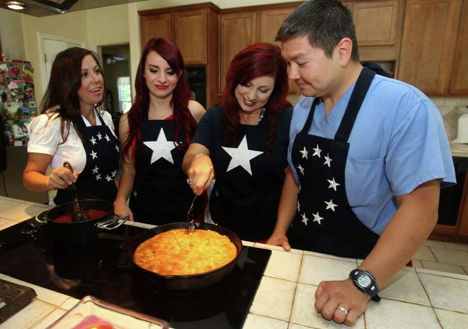 Sisters Elain (from left), Robyn and Dianne and Delfino Flores gather around a pot of chili and a pan of cornbread. Photo: JOHN DAVENPORT, SAN ANTONIO EXPRESS-NEWS / SAN ANTONIO EXPRESS-NEWS (Photo can be sold to the public)