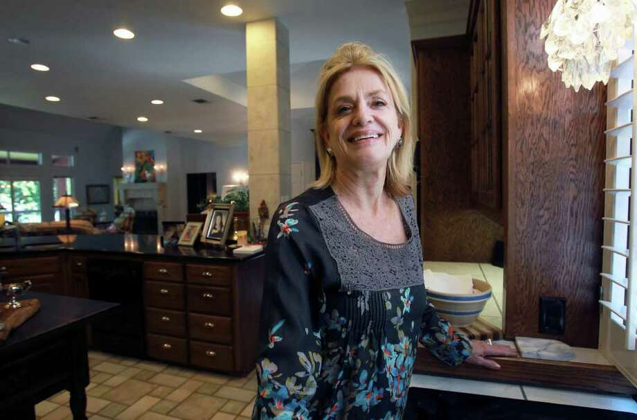 Nancy Stevens designed a kitchen to accomodate many cooks for her home at Lake Placid in Seguin. Photo: TOM REEL, SAN ANTONIO EXPRESS-NEWS / © 2011 San Antonio Express-News