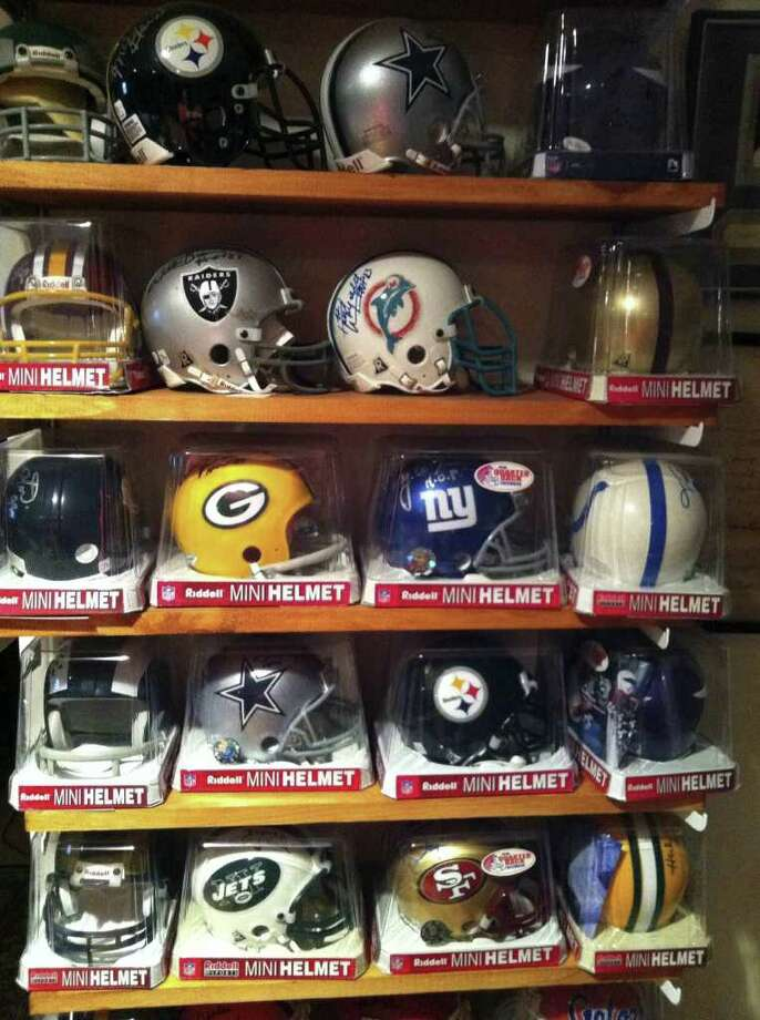 This undated photo courtesy of Emily R. Cohn  shows a collection of sports mini-helmets  in the home of Wendy Williams in Larchmont, N.Y. The collection belongs to Wendy's husband Ken Koch.   (AP Photo/Emily R. Cohn)