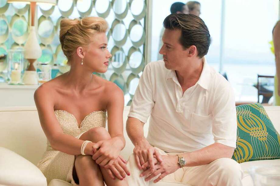 Peter Mountain/FilmDistrict Amber Heard and Johnny Depp star in THE RUM DIARY Peter Mountain/FilmDistrict Photo: PETER MOUNTAIN / PETER MOUNTAIN