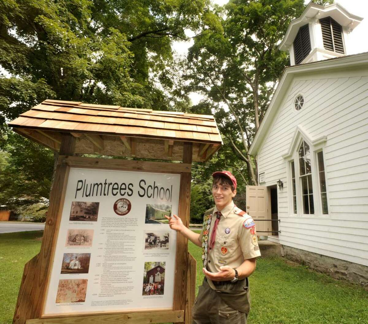 Life Scout Brandon Lennox talks about the Plumtrees School information sign he created for his eagle scout award,outside the Bethel school on monday.