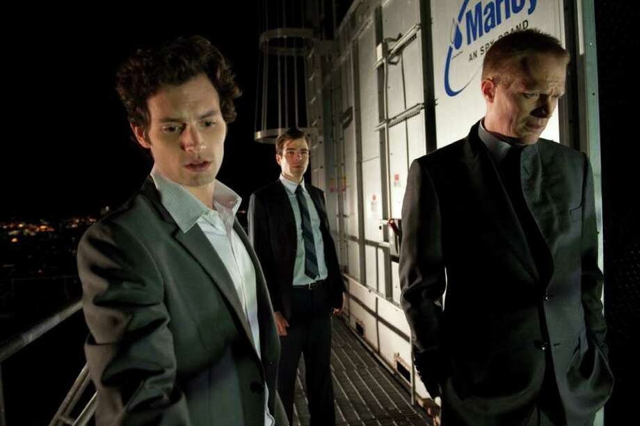 Walter Thomson/Roadside Attractions Penn Badgley as Seth Bregman, Zachary Quinto as Peter Sullivan, and Paul Bettany as Will Emerson in MARGIN CALL, written and directed by J.C. Chandor. Photo: JOJO WHILDEN