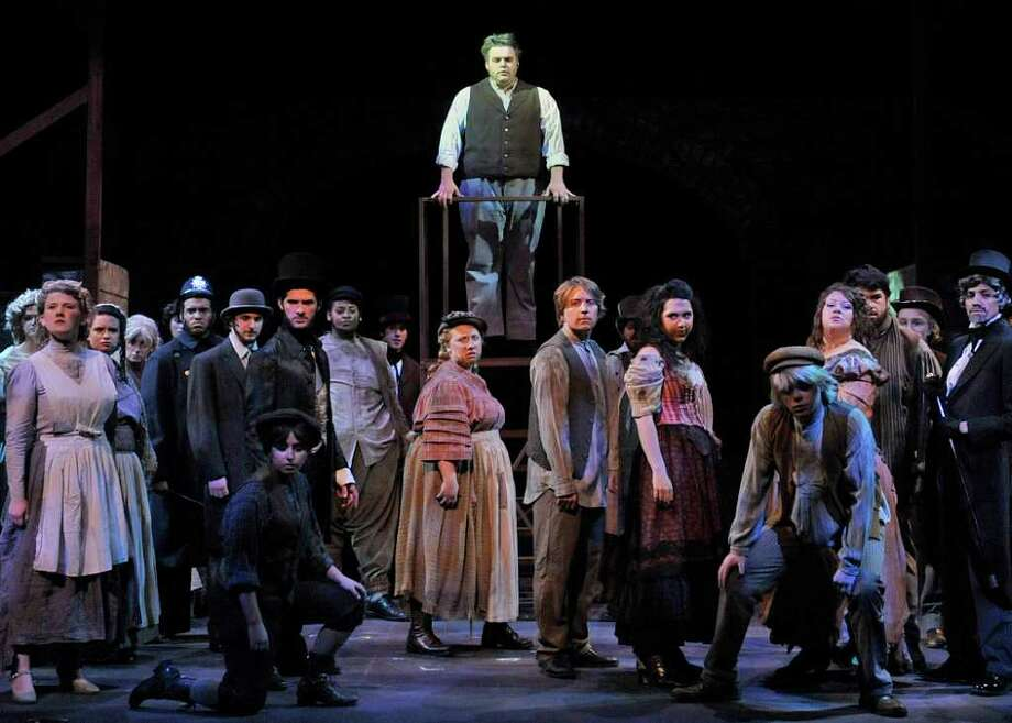 "The ensemble sings âÄúPrologue: The Ballad of Sweeney ToddâÄù in WestConn's fall production of ""Sweeney Todd."" Photo: Contributed Photo/Peggy Stewart, Contributed Photo"