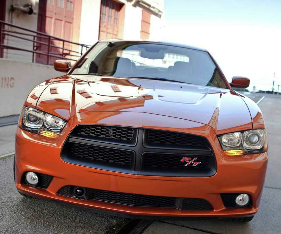 The front end of the redesigned 2011 Charger includes the new signature Dodge crosshair grille. COURTESY OF CHRYSLER GROUP LLC Photo: Chrysler Group LLC., COURTESY OF CHRYSLER GROUP LLC