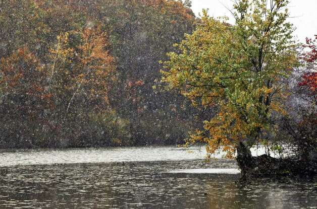 The first snow of the season falls amid autumn foliage at Ann Lee Pond in Colonie Thursday Oct. 27, 2011.    (John Carl D'Annibale / Times Union) Photo: John Carl D'Annibale