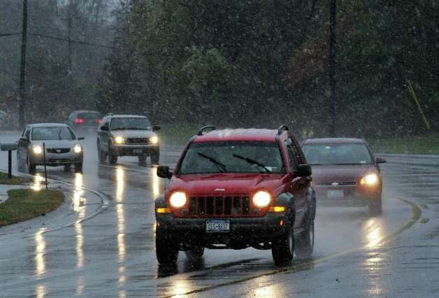 Traffic navigates through the first snow of the season falong Albany Shaker Road in Colonie Thursday Oct. 27, 2011.    (John Carl D'Annibale / Times Union) Photo: John Carl D'Annibale