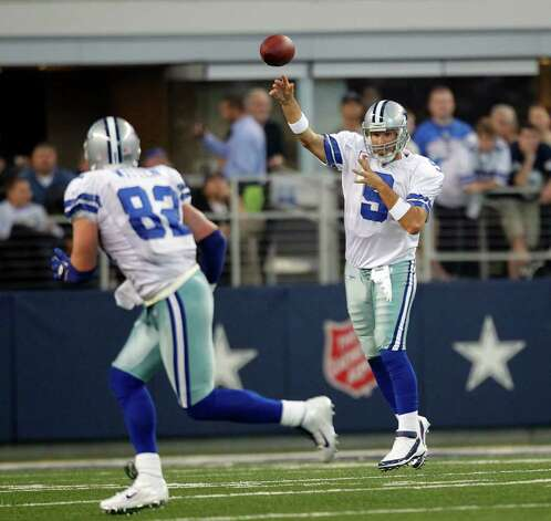 ARLINGTON, TX - OCTOBER 23: Quarterback Tony Romo #9 of the Dallas Cowboys passes to teammate Jason Witten #82 the St. Louis Rams at Cowboys Stadium on October 23, 2011 in Arlington, Texas. Photo: Layne Murdoch, Getty Images / 2011 Getty Images