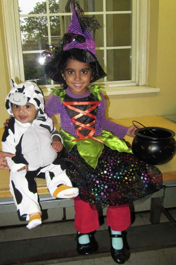 Eight-month-old Matthew Thomas and 5-year-old  Alyssa Thomas were among the many children who enjoyed the Halloween party at Westport Town Hall on Oct. 27. Photo: Kirk Lang / Westport News contributed
