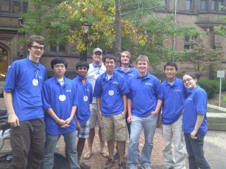 Two physics teams from Fairfield Warde High School recently won awards at the annual Yale Physics Olympics at Yale University. Team members are , left to right, Oliver Sawin; Hyunsoo Kim; Neil Gade; Dave Henry, teacher; Kei Nishimura-Gasparian; Caleb Bailey; John Dyer; Tong Liu and Nicole Beinstein. Photo: Contributed Photo