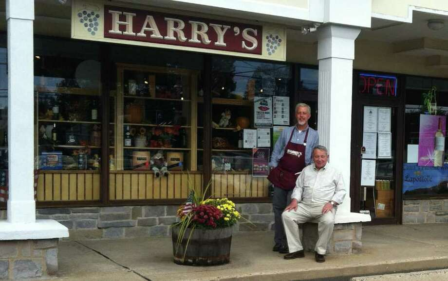 Patrick Montleone, general manager of Harry's Wine & Liquor Market, left, and Saul Pollack, the store's owner, pose outside the business Saul's father, Harry Pollack, founded 70 years ago. The original store was located in the present establishment's parking lot until it was demolished in 1968. Photo: Michael C. Juliano/Staff Photo