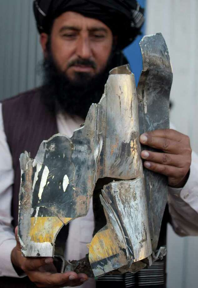 Pakistani tribal elder Karim Khan shows a piece of a missile reportedly fired by a U.S. drone. A drone strike killed four aides of a top Pakistani Taliban commander. One of them was an active member of a 120-member peace committee that negotiates with the Pakistani government. Photo: B.K. Bangash / Associated Press / AP