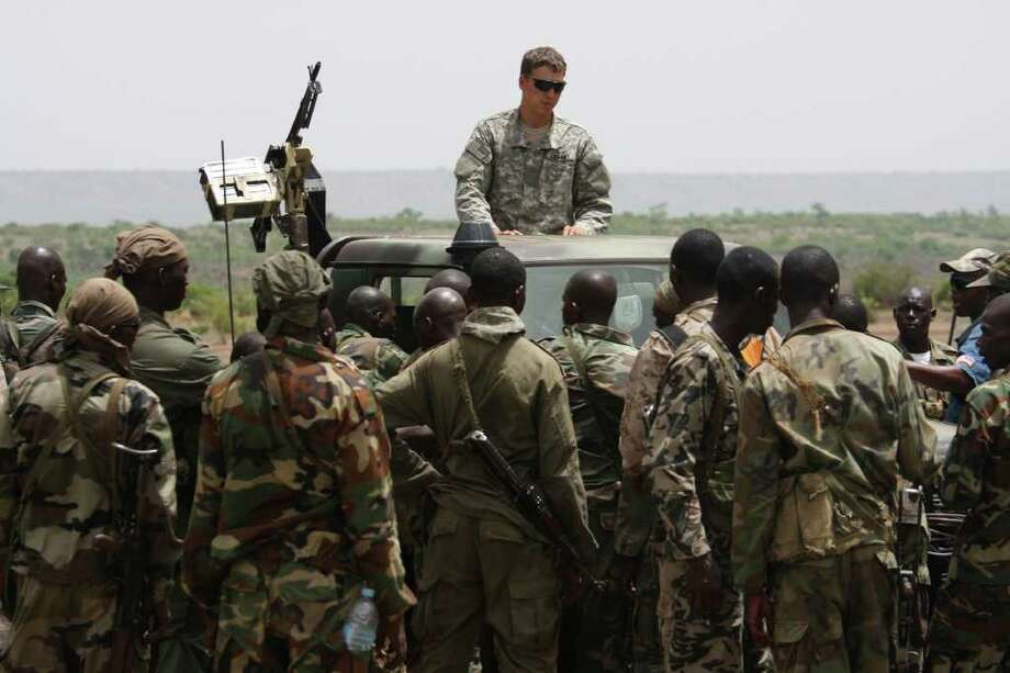 FILE - In this Monday, May 10, 2010 file photo, Malian special forces listen to instructions from a U.S. Special Forces soldier on counter-ambush tactics in Kita, Mali, during a joint training exercise. While putting few U.S. troops at risk, the United States is providing intelligence and training to fight militants across the continent, from Mauritania in the west along the Atlantic Ocean, to Somalia in the east along the Indian Ocean. Photo: Alfred De Montesquiou, AP / AP