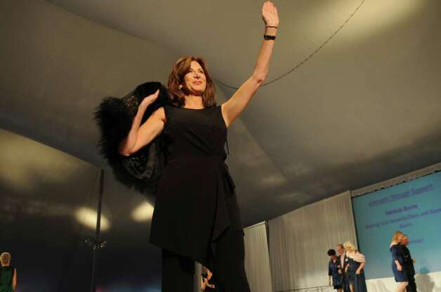 Breast cancer surviver Debbi O'Shea, the personal shopper at Richards since 2001, walks the runway during at the Breast Cancer Alliance's 16th annual benefit luncheon and fashion show at the Hyatt Regency Greenwich Thursday, Oct. 27, 2011. Photo: Helen Neafsey / Greenwich Time