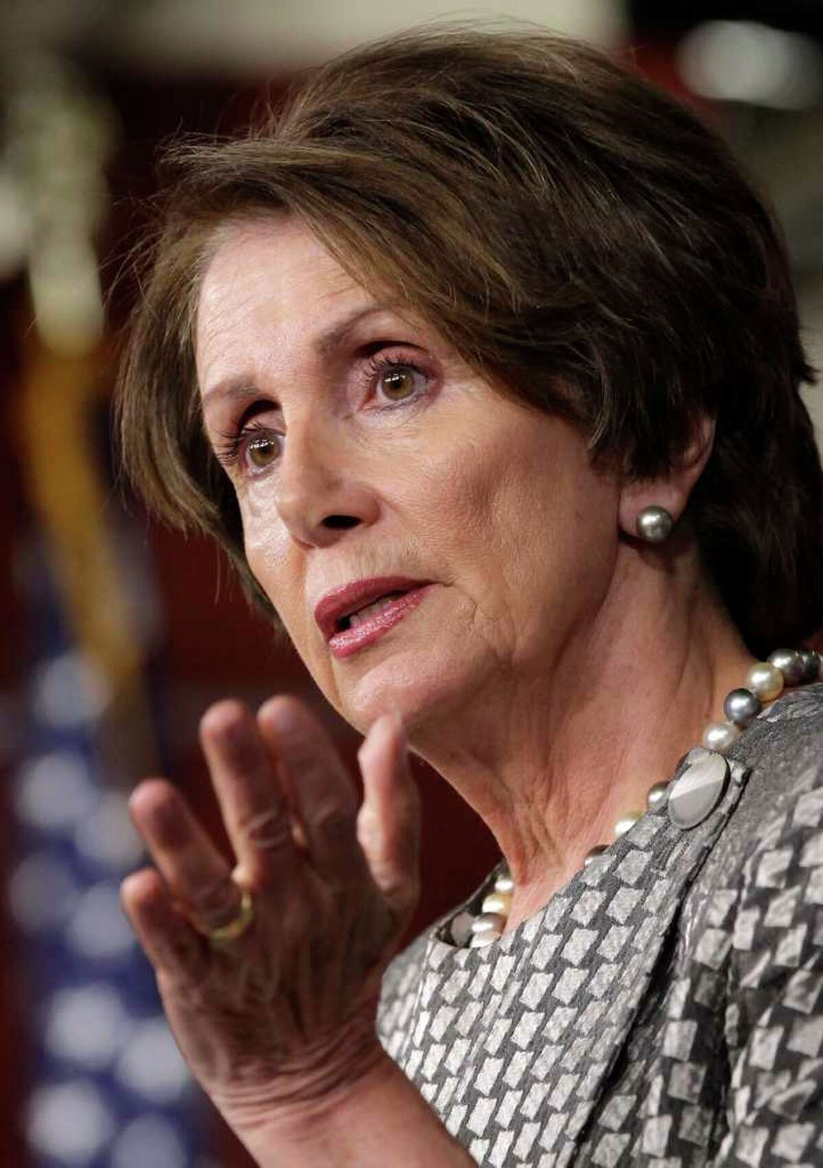 House Minority Leader Nancy Pelosi, D-Calif., talks to reporters to caution the deficit reduction supercommittee about not using retirement benefits to fix the nation's debt problems, Thursday, Oct. 27, 2011, on Capitol Hill in Washington. (AP Photo/J. Scott Applewhite)