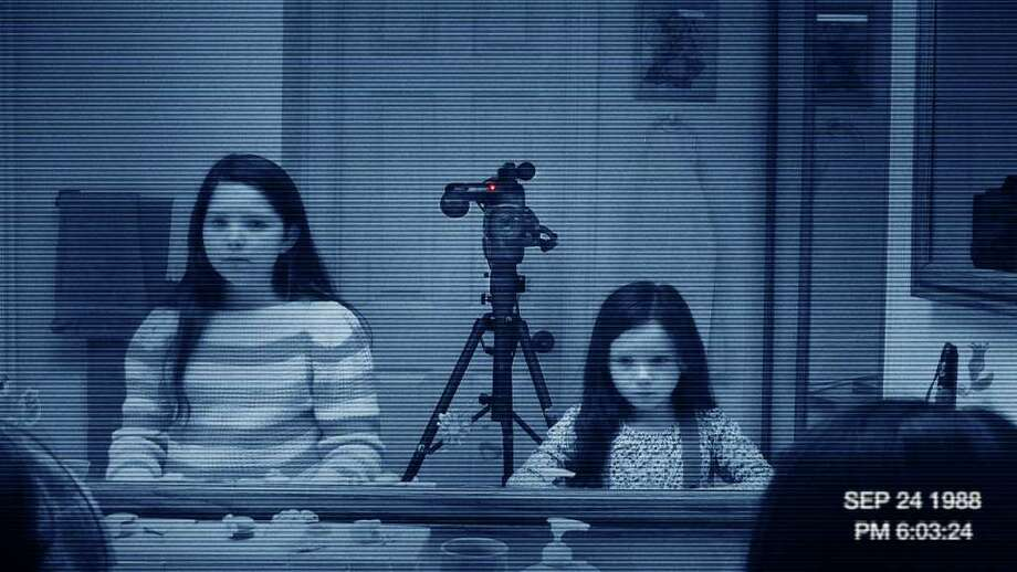 PARAMOUNT PICTURES SPOOKY: In Paranormal Activity 3, Katie (Chloe Csengery, left) and Kristi Rey (Jessica Tyler Brown) deal with scary issues that are out of this world. / © 2011 Paramount Pictures. All Rights Reserved.