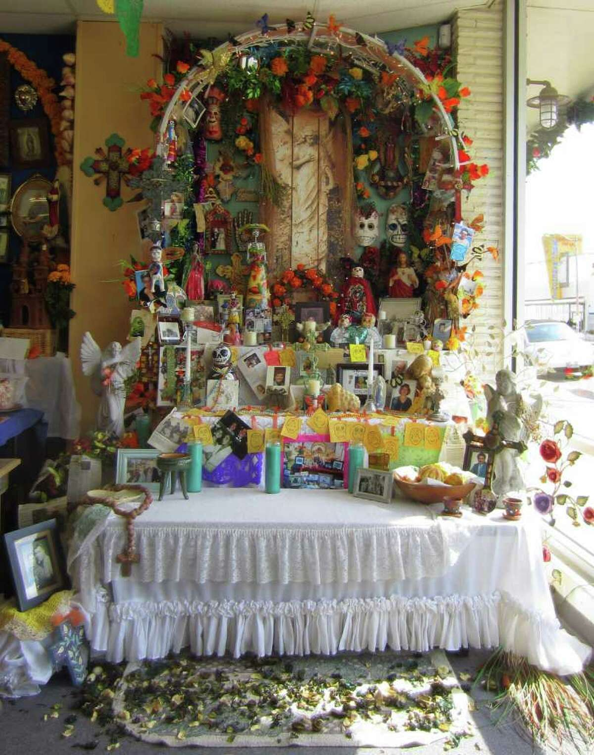 Artist Judy Turner designed a community Day of the Dead altar on view at Casa Ramirez. Visitors are invited to leave tributes to the deceased.