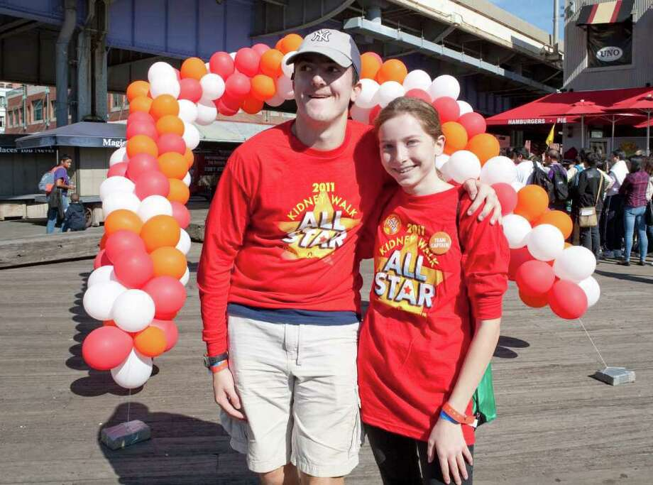 Siblings Matthew and Meghan Podolsky recently walked in a 5-K Kidney Walk to raise money for the National Kidney Foundation at New York's South Street Seaport. They participated in the walk in honor of their father, Fred, who received a kidney transplant 10 years ago. Photo: Contributed Photo