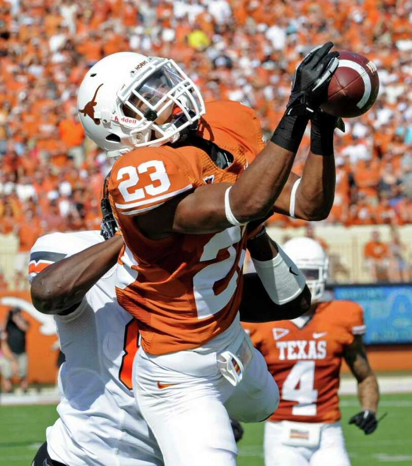 UT cornerback Carrington Byndom pulls down a pass intended for Oklahoma State's Justin Blackmon. Upon review, however, it was ruled that Byndom came down out of bounds. MICHAEL THOMAS/ASSOCIATED PRESS Photo: AP