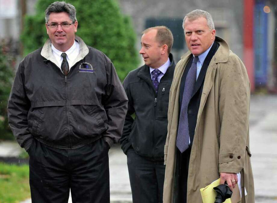 NY State Police investigators John Ogden, left, Albro Fancher and special prosecutor Trey Smith, at right, outside Rensselaer County Courthouse following meeting with a grand jury investigating ballot fraud in the 2009 Working Families Party primary in Troy Thursday Oct. 27, 2011.    (John Carl D'Annibale / Times Union) Photo: John Carl D'Annibale / 00015163A