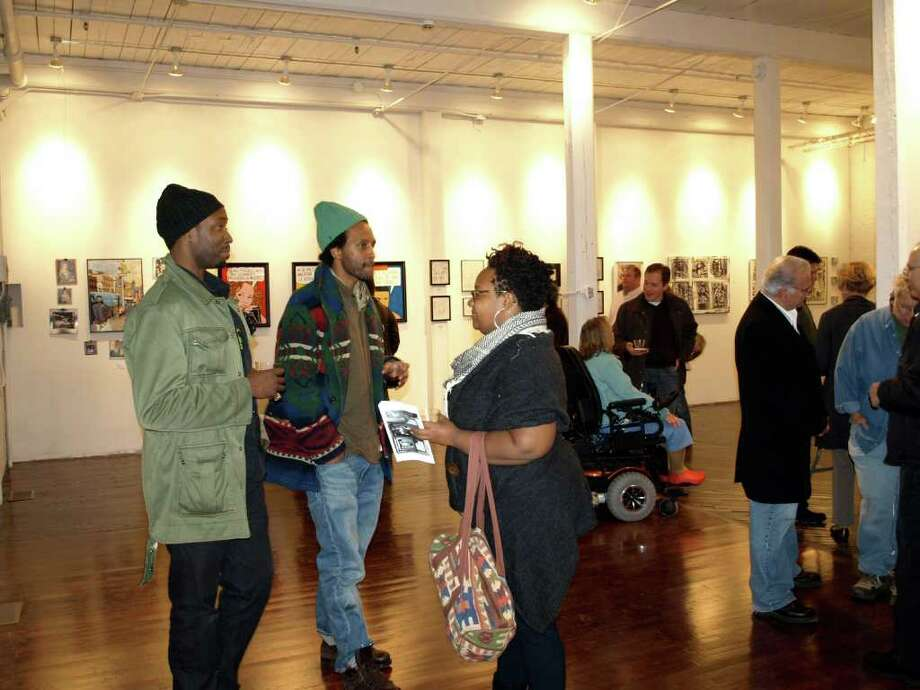 The third annual Bridgeport ArtTrail will feature about 30 venues and hundreds of performing and visual artists Thursday, Nov. 10, through Sunday, Nov. 13. Above, visitors attend a reception at Gallery 305K on Knowlton Street during last year's event. Photo: Contributed Photo
