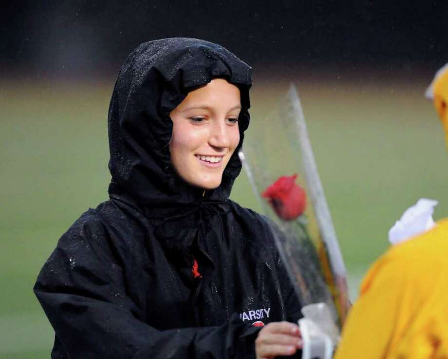 Greenwich senior soccer player Hayden Stein receives a flower at the start of girls high school soccer match between Greenwich High School and New Canaan High School at Greenwich, Thursday night, Oct. 27, 2011.  The seniors on the Greenwich High School team were honored at the start of the game. Photo: Bob Luckey / Greenwich Time