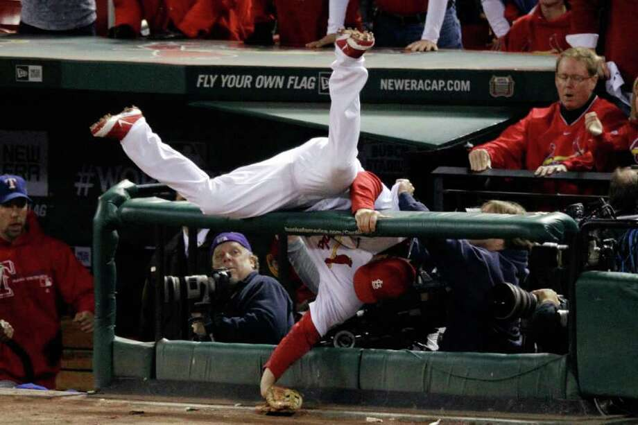 Cardinals third baseman David Freese falls into the camera while going after a foul ball. Photo: Rob Carr, Getty / 2011 Getty Images