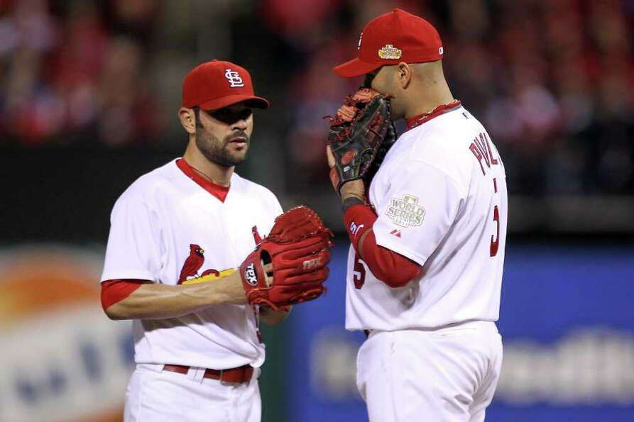 Jaime Garcia (54) and Albert Pujols (5) of the St. Louis Cardinals talk on the mound.
