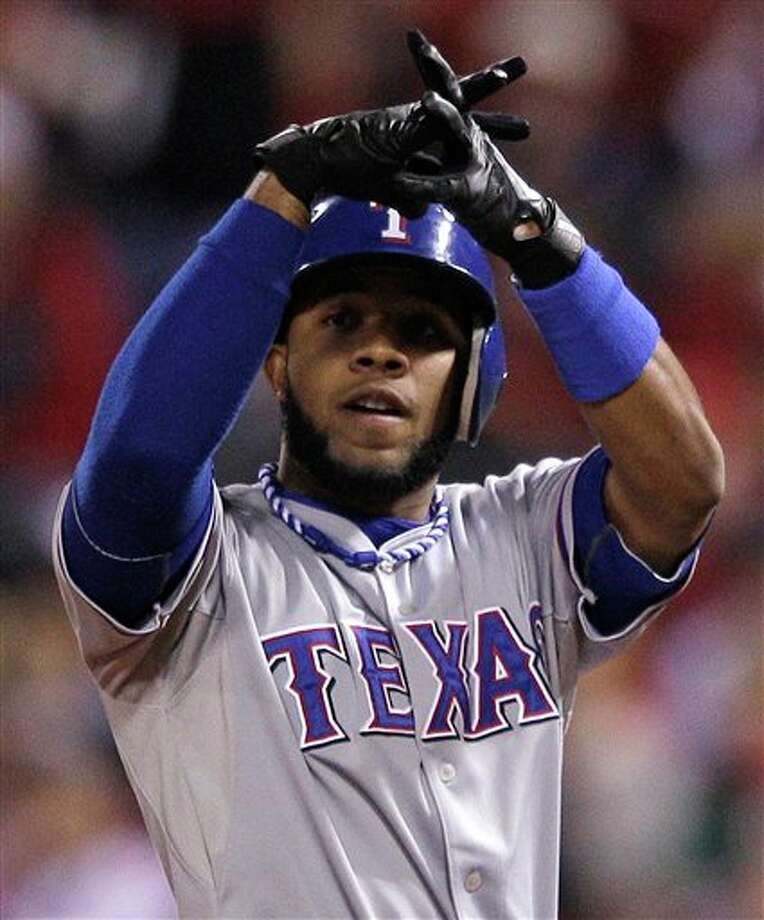 Texas Rangers' Elvis Andrus reacts after hitting a single during the first inning of Game 6 of baseball's World Series against the St. Louis Cardinals Thursday, Oct. 27, 2011, in St. Louis. (AP Photo/Matt Slocum) Photo: Associated Press