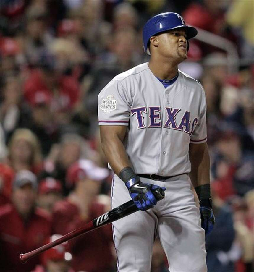 Texas Rangers' Adrian Beltre reacts after striking out during the first inning of Game 6 of baseball's World Series against the St. Louis Cardinals Thursday, Oct. 27, 2011, in St. Louis. (AP Photo/Charlie Riedel) Photo: Associated Press
