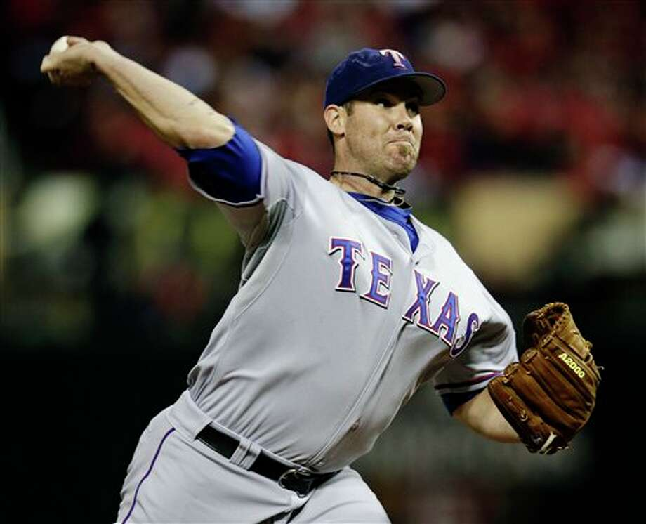 Texas Rangers starting pitcher Colby Lewis throws during the first inning of Game 6 of baseball's World Series against the St. Louis Cardinals Thursday, Oct. 27, 2011, in St. Louis. (AP Photo/Matt Slocum) Photo: Associated Press