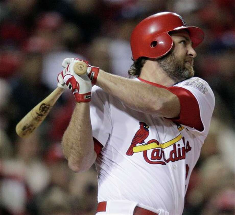 St. Louis Cardinals' Lance Berkman hits a two-run home run during the first inning of Game 6 of baseball's World Series against the Texas Rangers Thursday, Oct. 27, 2011, in St. Louis. (AP Photo/Charlie Riedel) Photo: Associated Press
