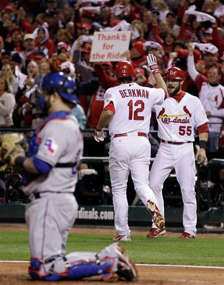St. Louis Cardinals' Lance Berkman is congratulated by Skip Schumaker after Berkman hit a two-run home run during the first inning of Game 6 of baseball's World Series against the Texas Rangers Thursday, Oct. 27, 2011, in St. Louis. (AP Photo/Matt Slocum) Photo: Associated Press