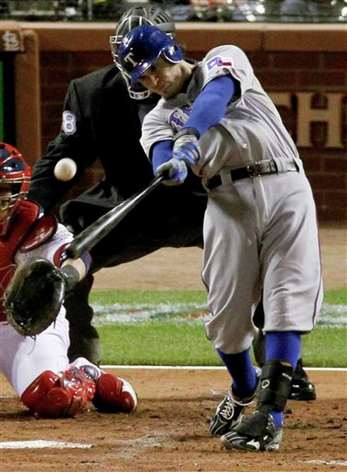 Texas Rangers' Ian Kinsler hits a RBI double during the second inning against the St. Louis Cardinals at Game 6 of baseball's World Series Thursday, Oct. 27, 2011, in St. Louis. (AP Photo/Jeff Roberson) Photo: Associated Press