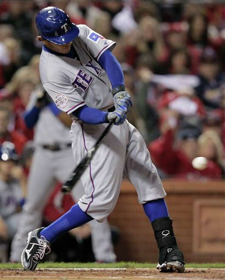 Texas Rangers' Ian Kinsler hits a run scoring double during the second inning of Game 6 of baseball's World Series against the St. Louis Cardinals Thursday, Oct. 27, 2011, in St. Louis. (AP Photo/Charlie Riedel) Photo: Associated Press