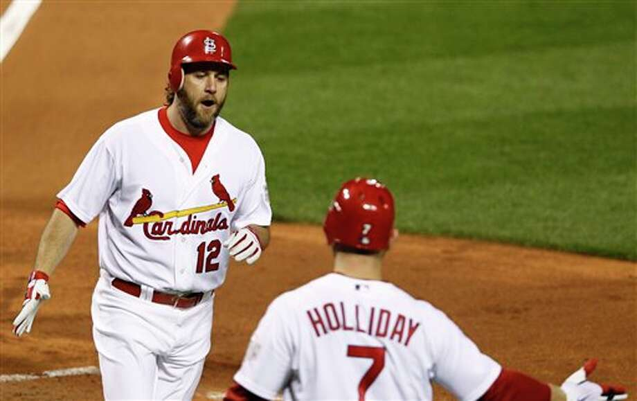 St. Louis Cardinals' Lance Berkman is congratulated by Matt Holliday (7) after Berkman hit a two-run home run during the first inning of Game 6 of baseball's World Series against the Texas Rangers Thursday, Oct. 27, 2011, in St. Louis. (AP Photo/Eric Gay) Photo: Associated Press