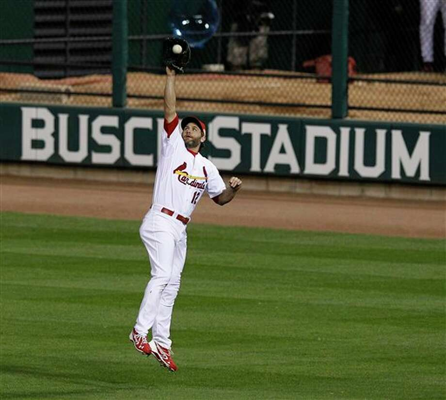 St. Louis Cardinals' Lance Berkman leaps to catch a ball hit by Texas Rangers' Elvis Andrus during the second inning of Game 6 of baseball's World Series Thursday, Oct. 27, 2011, in St. Louis. (AP Photo/Eric Gay) Photo: Associated Press