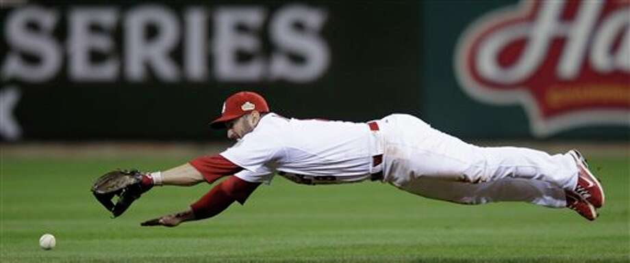 St. Louis Cardinals' Nick Punto can't get a ball hit by Texas Rangers' Michael Young during the third inning of Game 6 of baseball's World Series Thursday, Oct. 27, 2011, in St. Louis. (AP Photo/Matt Slocum) Photo: Associated Press