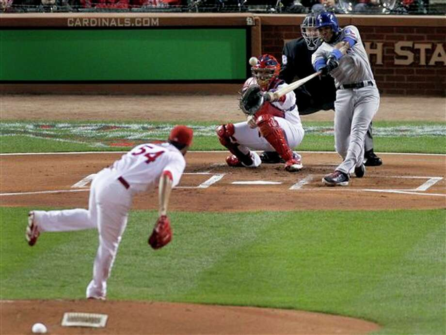 Texas Rangers' Elvis Andrus singles off a pitch from St. Louis Cardinals' Jaime Garcia during the first inning of Game 6 of baseball's World Series Thursday, Oct. 27, 2011, in St. Louis. (AP Photo/Jeff Roberson) Photo: Associated Press