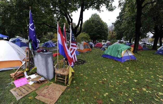 It was very quiet in the rain this morning at the Occupy Albany tent city in Academy Park in Albany, N.Y. October 26, 2011. (Skip Dickstein/Times Union) Photo: Skip Dickstein / 2011