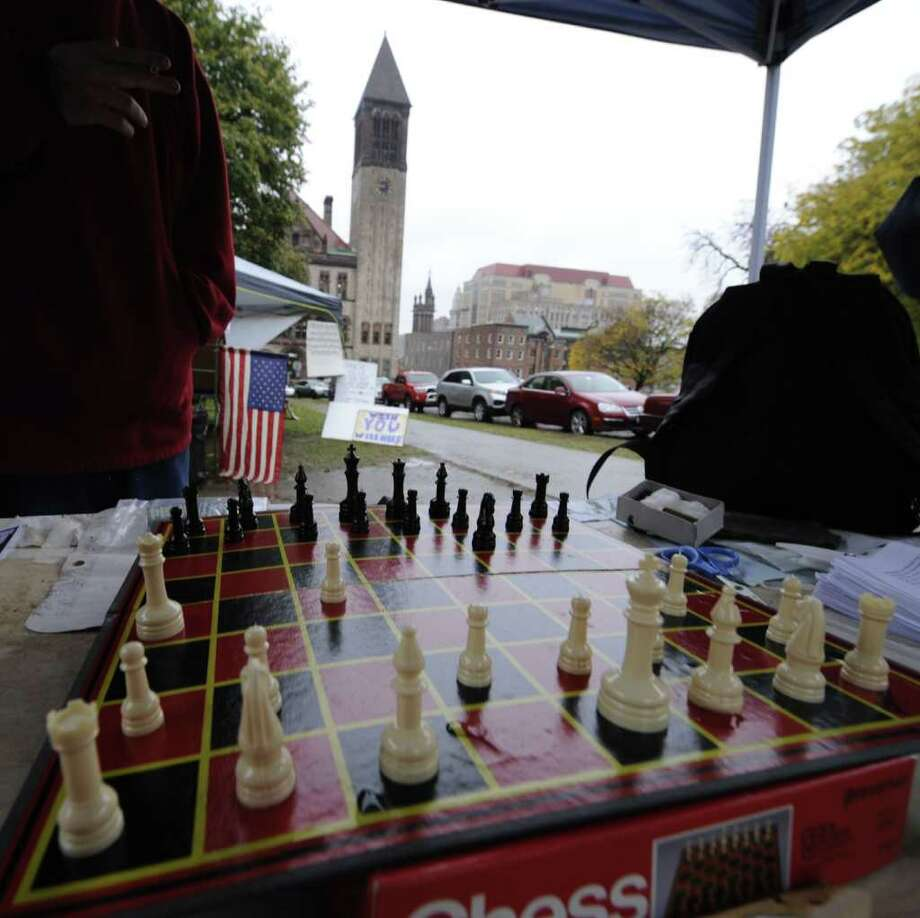 An unfinished game of chess at the Occupy Albany tent city in Academy Park in Albany, N.Y. October 26, 2011. Albany City Hall is seen in the background. (Skip Dickstein/Times Union) Photo: Skip Dickstein / 2011