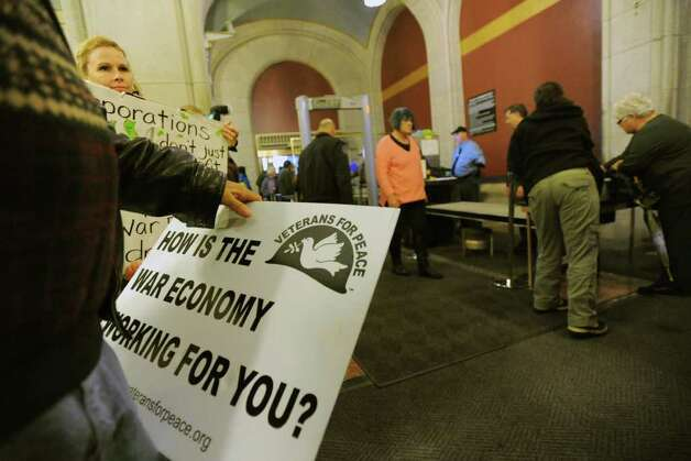 Occupy Albany participants go throught the metal detector during their march up to Governor Andrew Cuomo's office int the Capitol in Albany, N.Y. Thursday, Oct. 27, 2011. The protesters are protesting his attempts to shut down Occupy Albany and to demand that he extend the Millionaires Tax and re-invest that money into our schools and communities. (Lori Van Buren / Times Union Photo: Lori Van Buren
