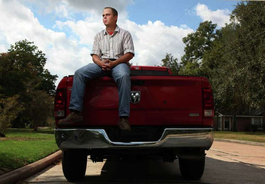 Dustin Ford, 25, survived an assault from a former co-worker who chased his red Dodge Ram and fired 10 shots at Ford, hitting the front, side and rear of his truck. Photo: Mayra Beltran / © 2011 Houston Chronicle
