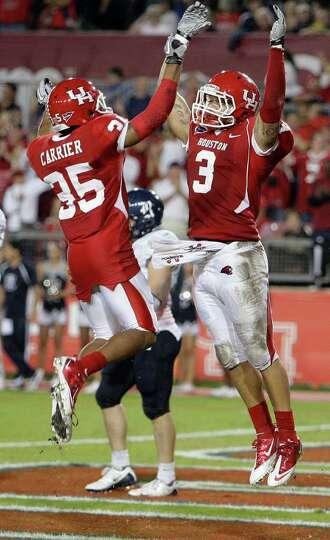 The University of Houston's Justin Johnson right celebrates teammate Tyron Carrier after Johnson's s